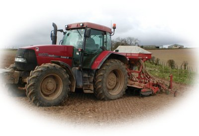 Photo of case tractor with seed drill
